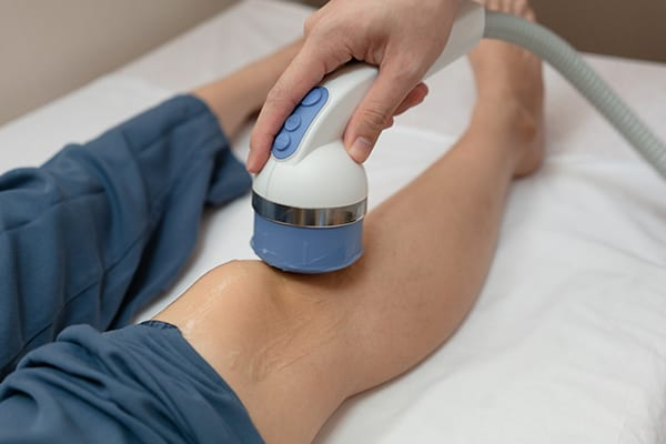 Burnaby Physiotherapy do Shockwave Therapy suffer from knee pain while walking.